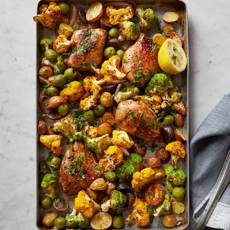 Photo of Garlic chicken with cauliflower, potatoes and olives tray bake by WW