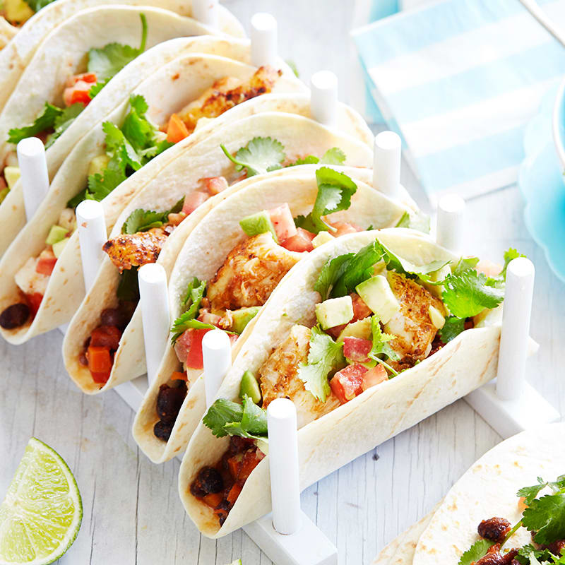 Photo of Tacos with grilled spicy fish, black beans and avocado salad by WW