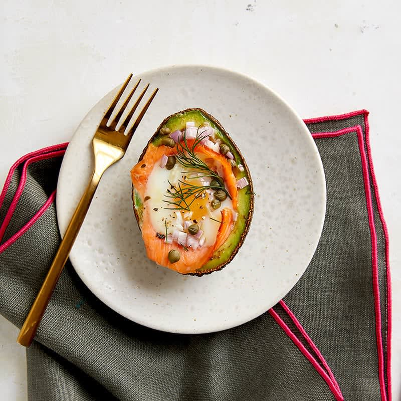Photo of Egg baked in avocado with smoked salmon, capers and dill by WW