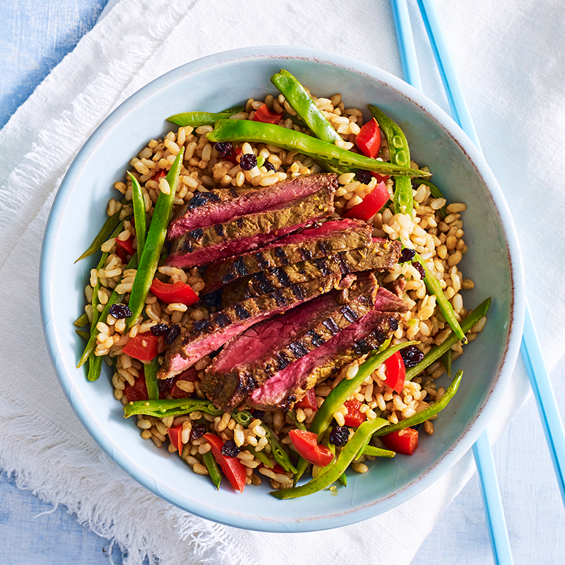 Photo of Turmeric, honey and sesame marinated beef with warm brown rice salad by WW