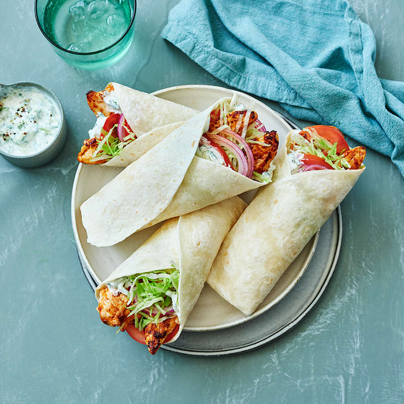 Photo of Butter chicken and cucumber raita wrap by WW