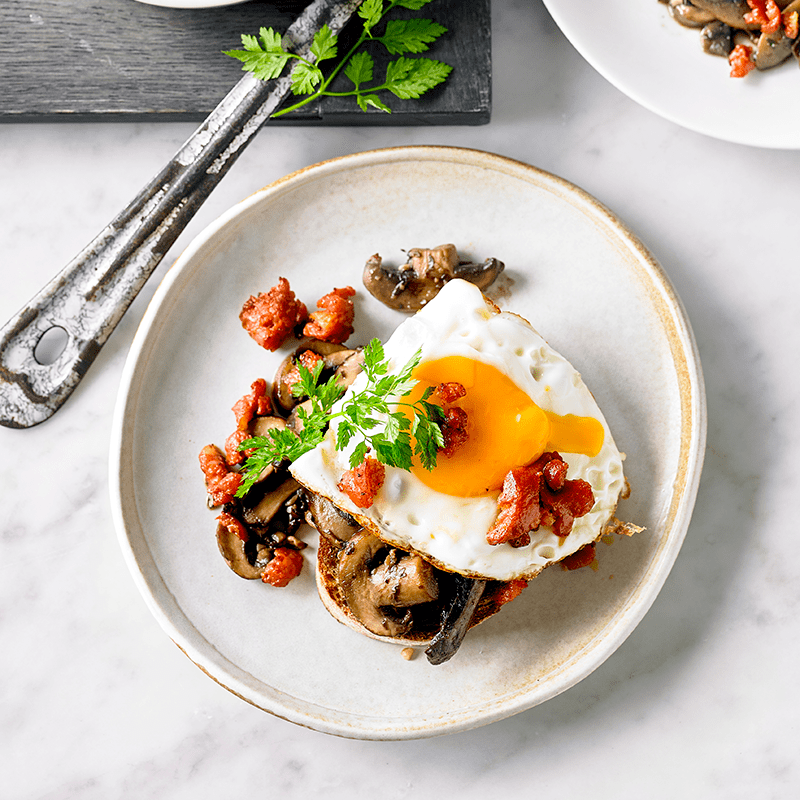 Photo of Spicy garlic mushrooms with fried egg and chorizo crumbs by WW