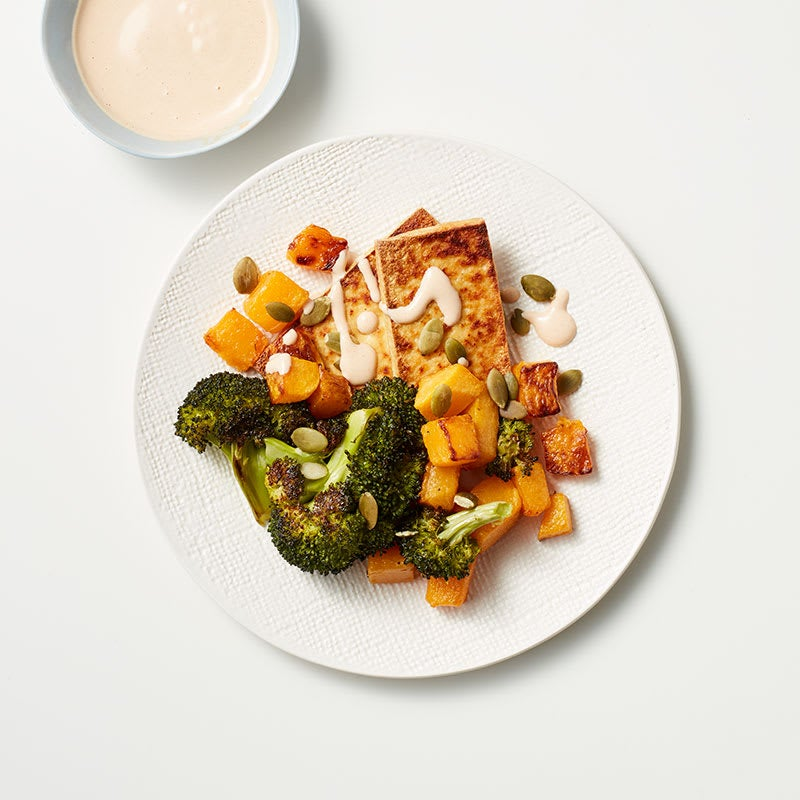Photo of Tofu, broccoli and pumpkin with creamy tahini sauce by WW