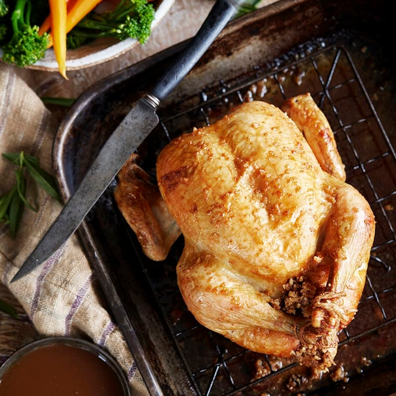Photo of Roast chicken with lemon and tarragon stuffing and white wine gravy by WW