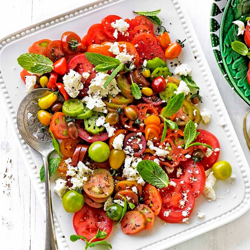 Photo of Heirloom tomato salad with mint and feta by WW