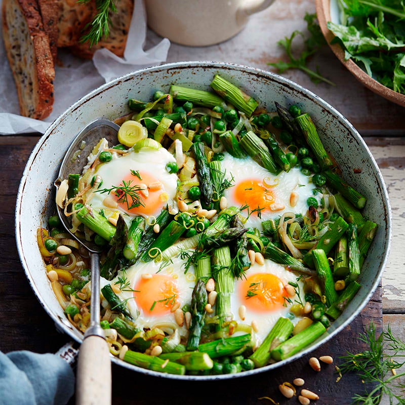Photo of Baked eggs with asparagus and peas by WW