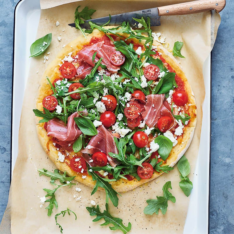 Photo of Anna's three-ingredient pizza dough with prosciutto,  rocket and feta by WW