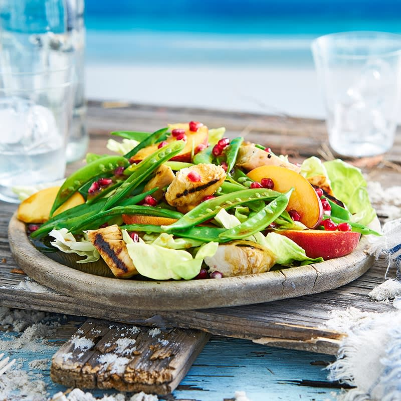 Photo of Grilled chicken, peach and herb salad with pomegranate dressing by WW