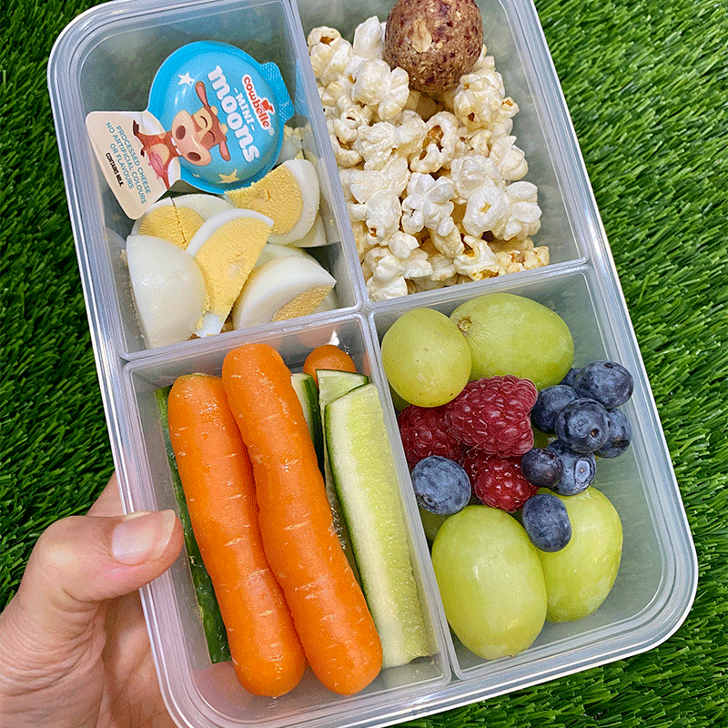 Photo of Anna's cranberry bliss ball and popcorn snack box by WW