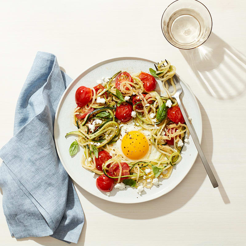 Photo of Egg in a zucchini noodle nest with tomato, basil and feta by WW