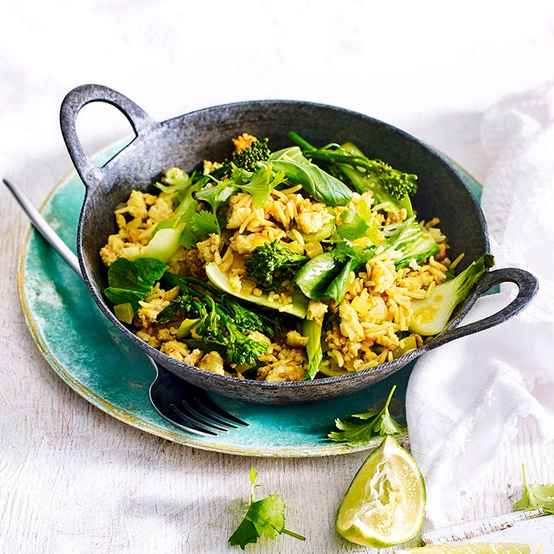 Photo of Turmeric spiced rice bowl with stir-fried chicken and greens by WW