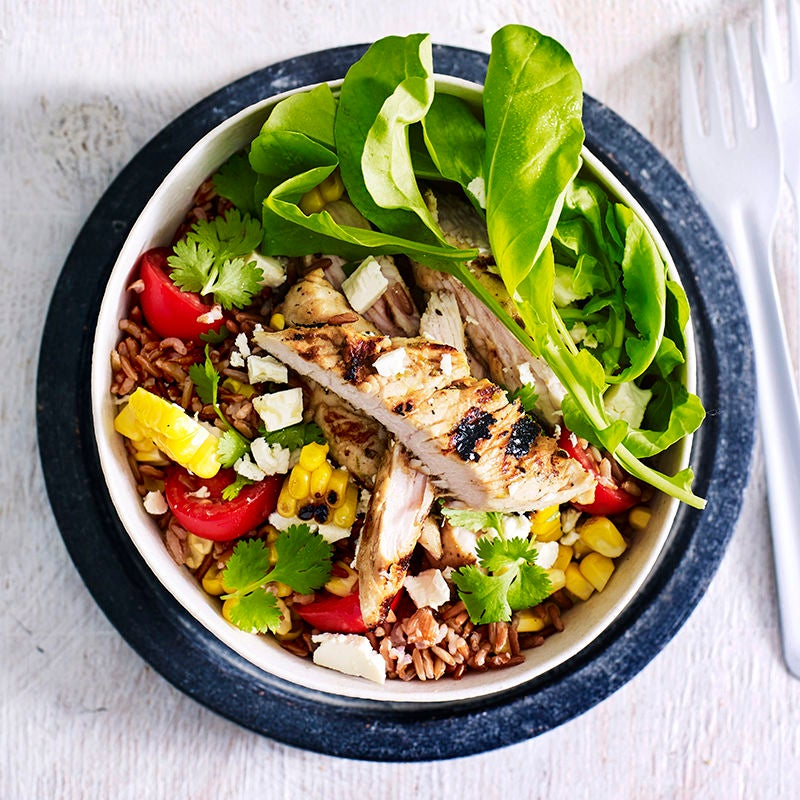Photo of Red rice bowl with grilled corn, lime and garlic turkey and feta by WW